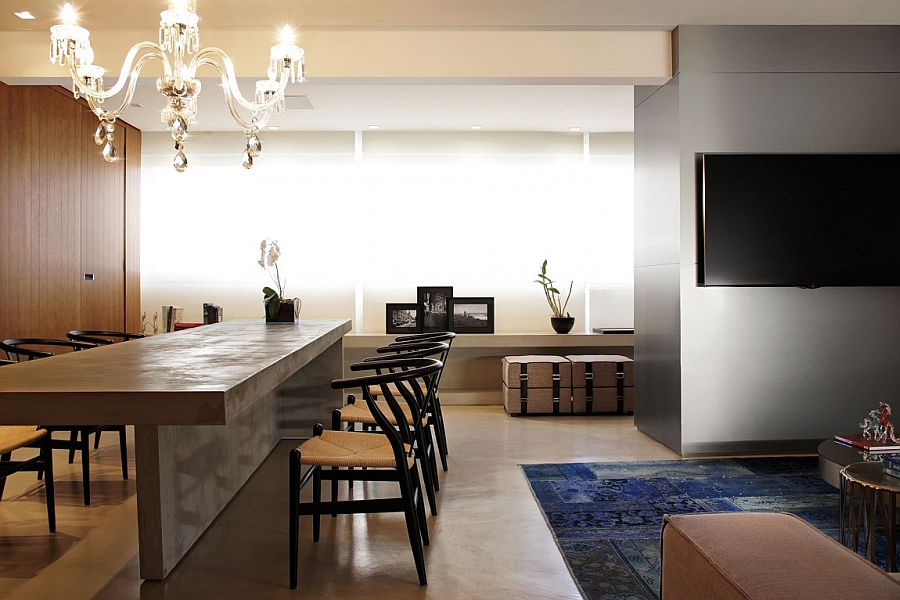 Concrete slab couple with wishbone chairs makes for a stunning dining space