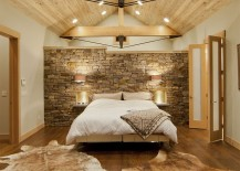 Contemporary bedroom with Montana limestone headboard wall and a wooden ceiling