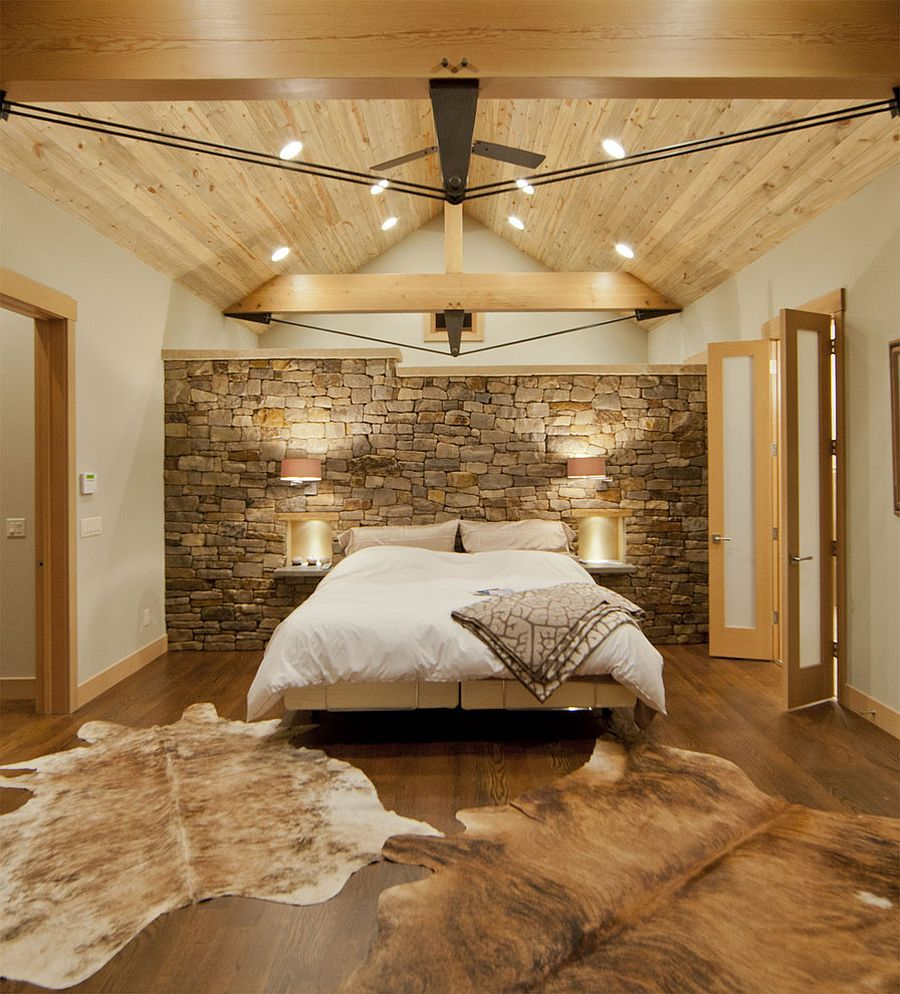 Contemporary bedroom with Montana limestone headboard wall and a wooden ceiling [Design: Kelly & Stone Architects]