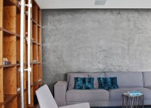 Contemporary-couch-in-gray-blends-into-the-cement-wall-backdrop-217x155