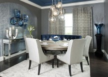 Contemporary dining room with a splash of blue, gray and a light colored rug