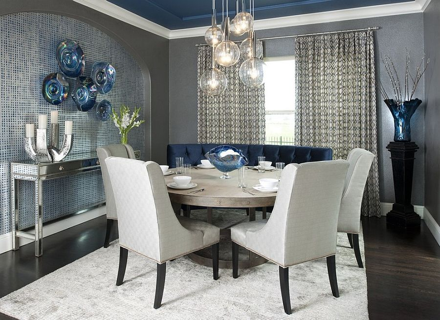 Contemporary dining room with a splash of blue, gray and a light colored rug [From: RSVP Design Services / Dallas Rugs]