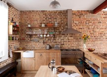 Contemporary-kitchen-in-London-with-brick-walls-and-wooden-workstation-217x155