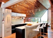 Contemporary kitchen in white sits at the heart of the modcentury modern remodel