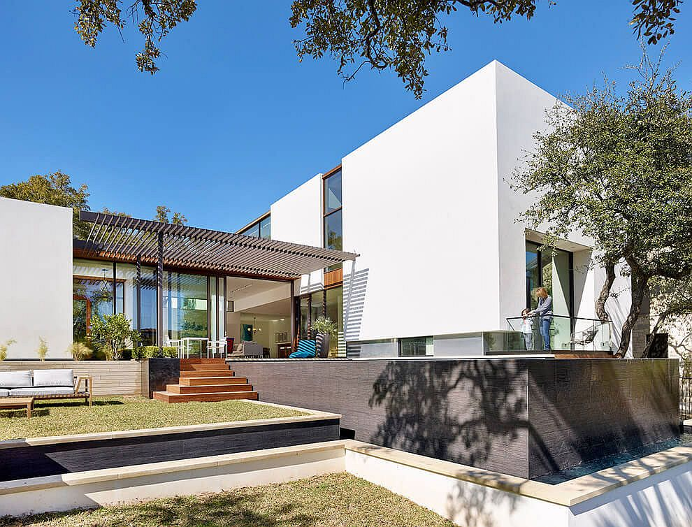 Contemporary private home in Austin with a negative edge pool and a lovely rear yard