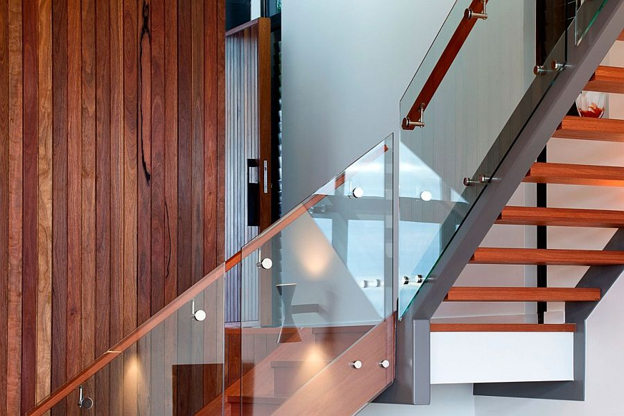 Contemporay wooden staircase with glass railing