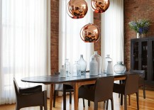 Copper-pendant-lights-from-Tom-Dixon-make-a-big-visual-statement-in-this-dining-room-217x155