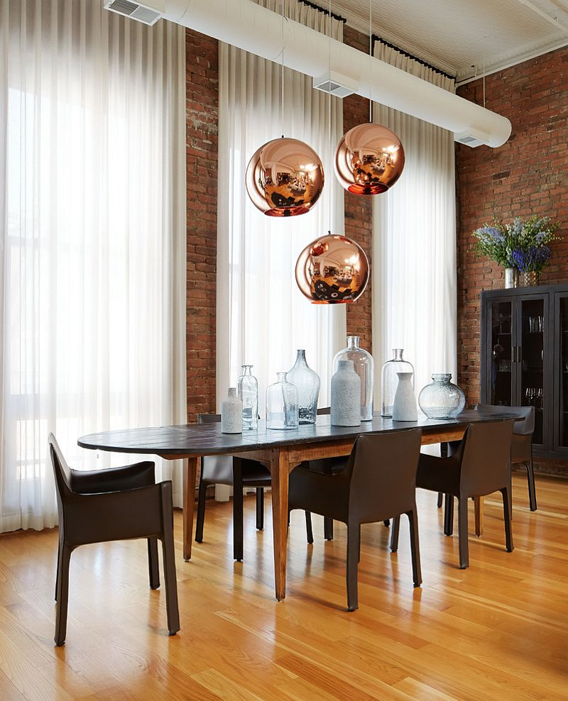 Copper pendant lights from Tom Dixon make a big visual statement in this dining room [Design: Jessica Lagrange Interiors]