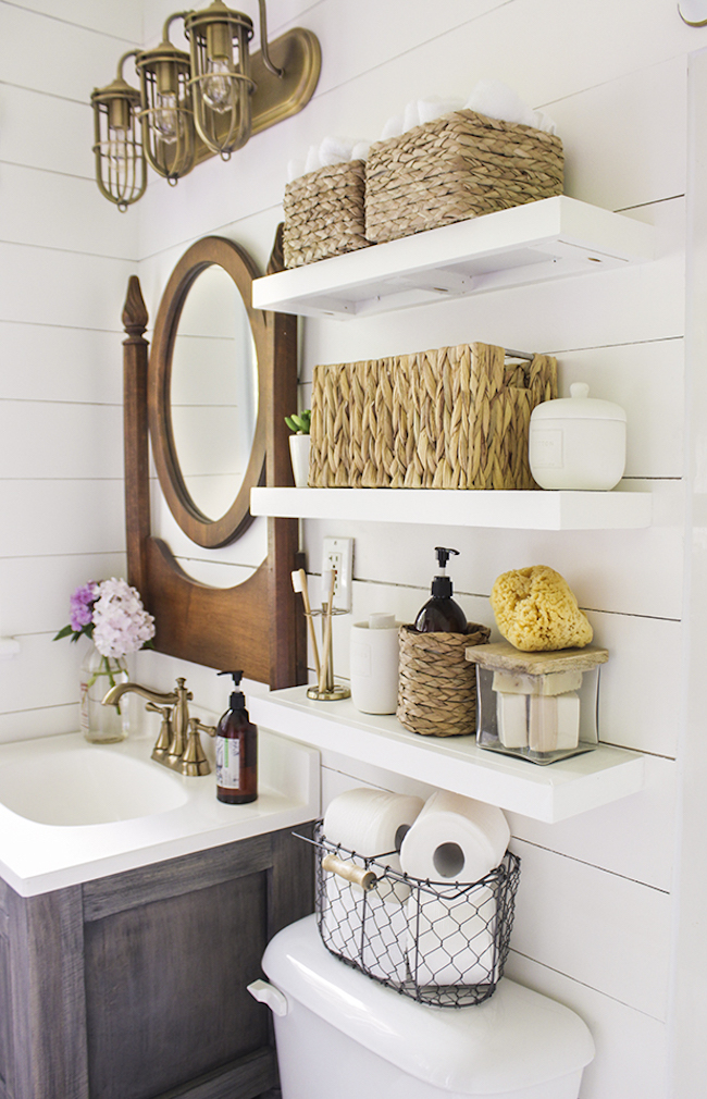 Country bathroom with shelves installed above toilet decoist for Bathroom storage ideas