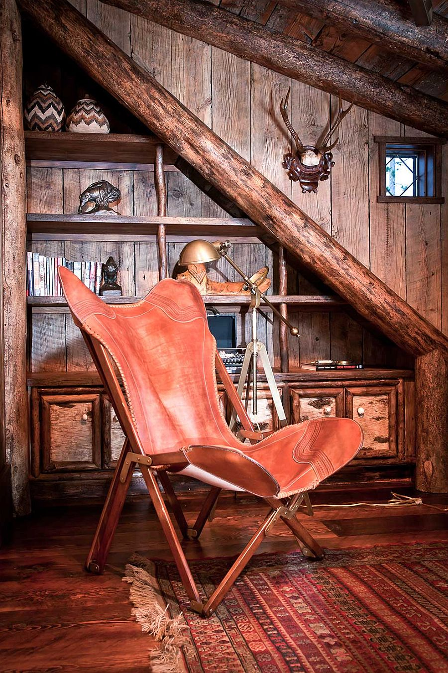Cozy reading nook with comfy chair and cuztom bookshelf