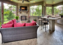Cozy sunroom with fireplace, plush couch, innovative ceiling design and TV