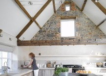 Creative use of the stone wall in the contemporary white kitchen