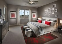 Curated-collection-of-empty-frames-on-the-wall-brings-class-to-the-contemporary-bedroom-in-gray-217x155