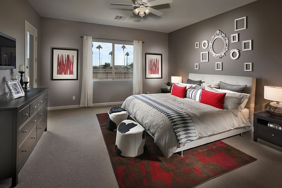 curated collection of empty frames on the wall brings class to the contemporary bedroom in gray