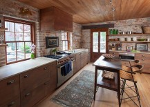 Custom island and chairs bring antique charm to the rustic kitchen