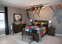 Custom mural on the wall and sports bedding from Pottery Barn for the boys' bedroom