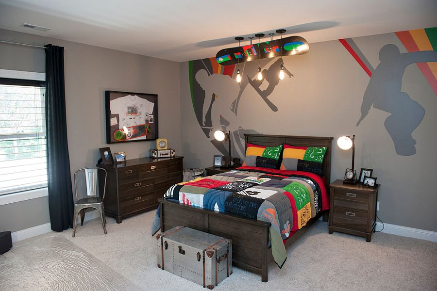 Custom mural on the wall and sports bedding from Pottery Barn for the boys' bedroom [Design: Kimberly Fox Designs]