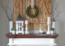 DIY barn wood shutters over a fireplace mantel