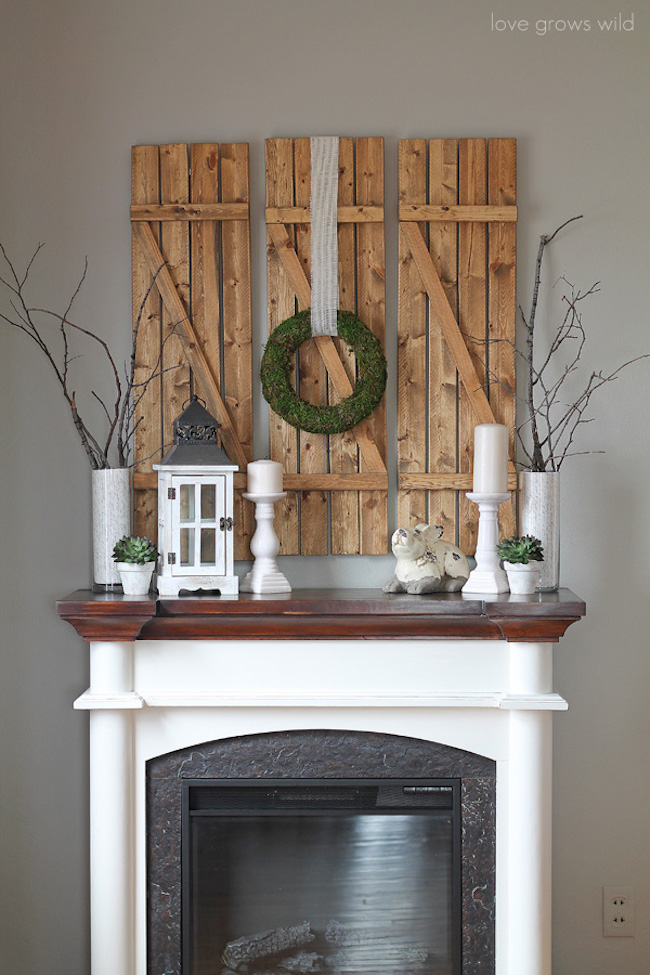 DIY barn wood shutters over a fireplace mantel
