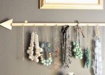 DIY golden arrow jewelry holder