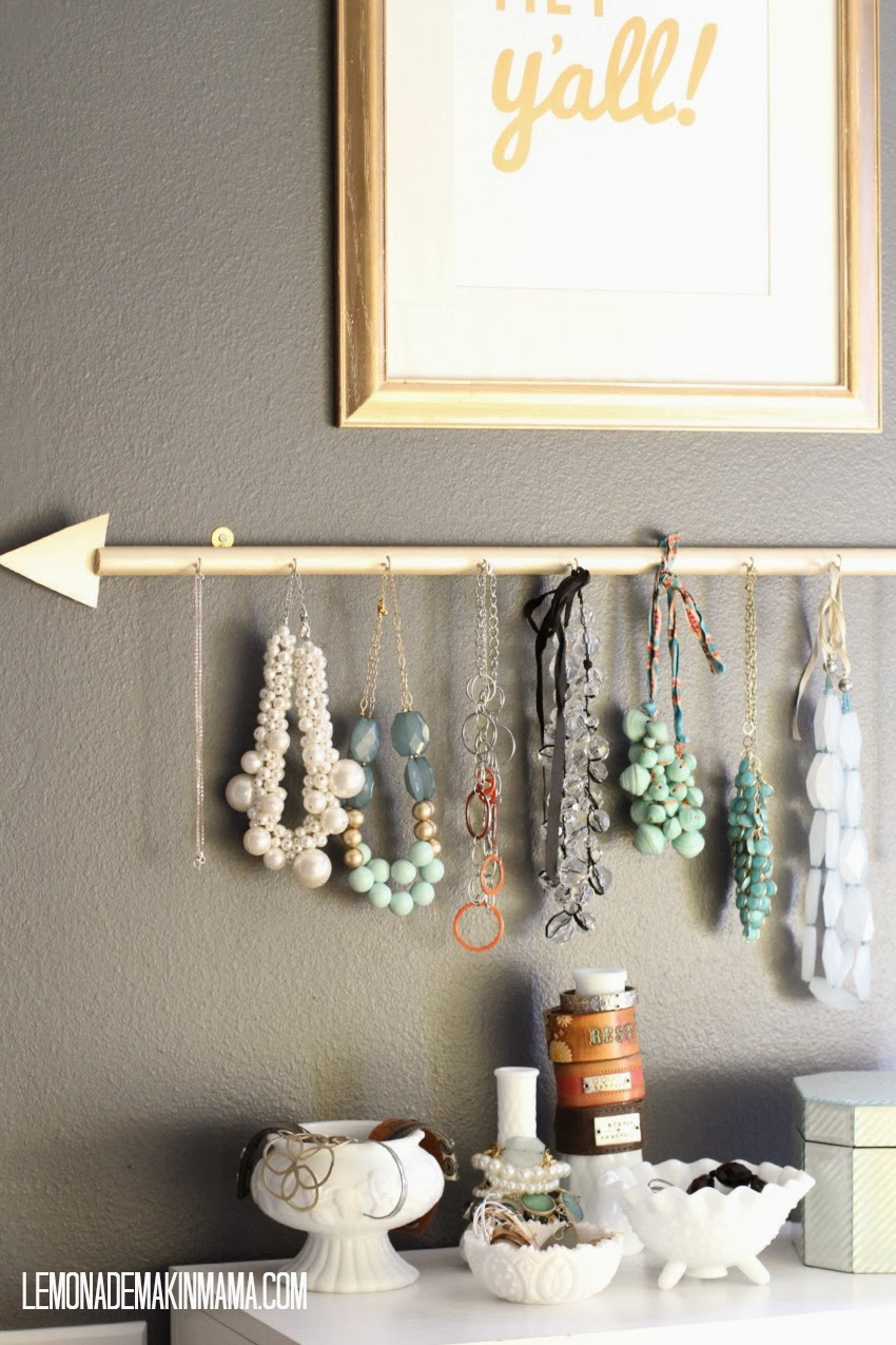 DIY golden arrow jewelry holder