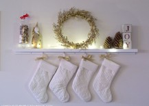 DIY mantel with simple Christmas decor 217x155 8 Festive Ways to Hang Stockings When You Dont Have a Fireplace