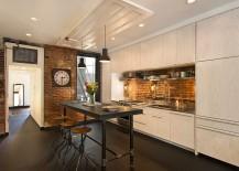 Dark flooring anchors the industrial kitchen with smart brick walls [Design: Bennett Frank McCarthy Architects]