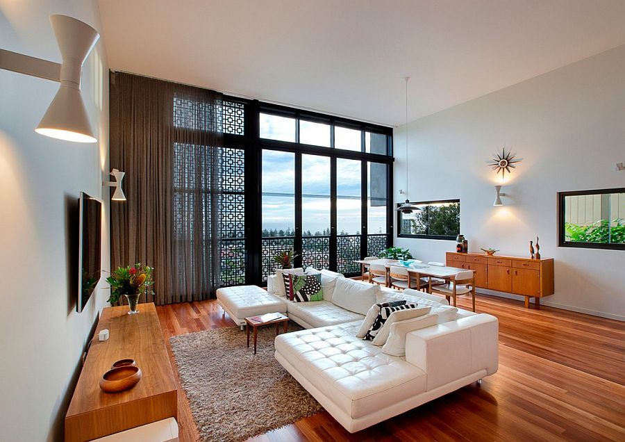 Decorative screening and drapes for the living room allow you to shift between stunning views and privacy