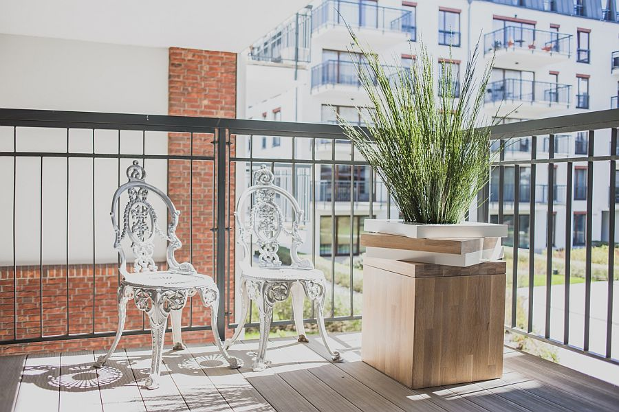 Decorating the small balcony with a couple of chairs, a side table and a hint of greenery