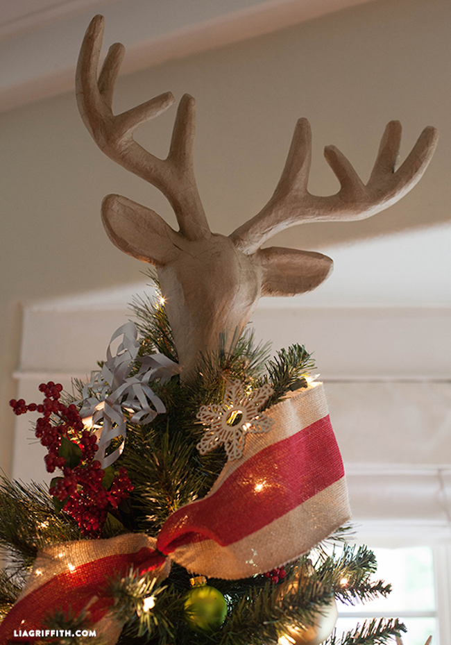 Faux reindeer head tree topper
