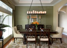 Dining room takes it color scheme and cue from the lovely rug