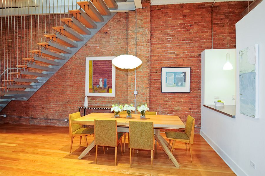 Dining room with Nelson pendant lamp and lovely artwork [Design: Modern Chicago Homes]