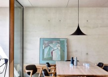 Dining room with a hint of black and concrete walls