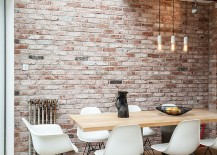 Dining space in the corner of industrial living area with conservatory roof 217x155 50 Bold and Inventive Dining Rooms with Brick Walls