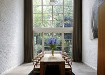 Dramatic-double-height-dining-room-woth-brick-walls-and-the-classic-Wishbone-chair-217x155
