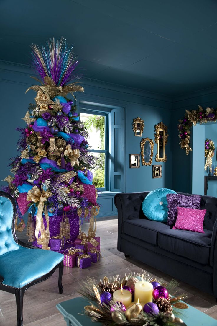 Dramatic tree topper in gold, purple, and blue