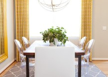 Drapes and rug add yellow and gray to the neutral dining room