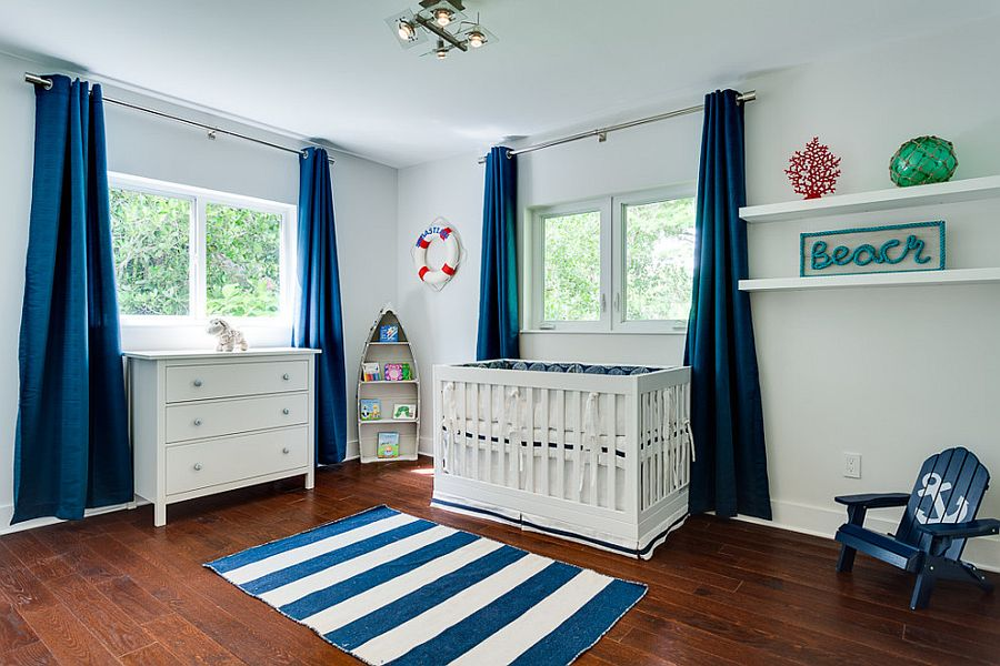 Drapes bring a splash of solid color to the nursery in white
