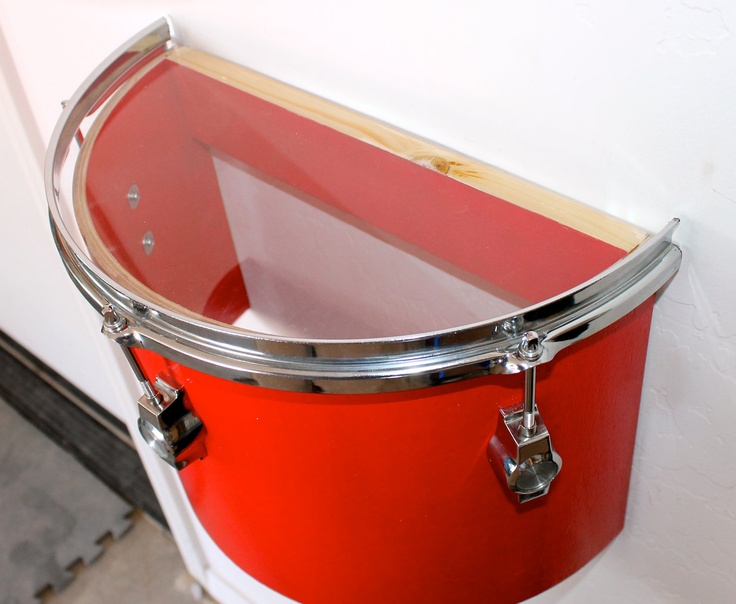 Drum cut in half to make a shelf
