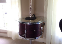 Drum-side-table-using-repurposed-student-tom-rom-drum-with-wine-cork-and-glass-top-217x155