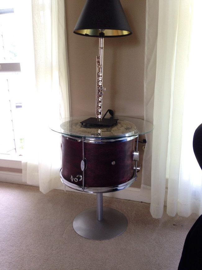 Drum side table using repurposed student tom rom drum with wine cork and glass top