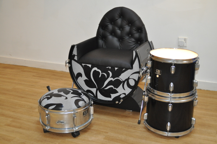 Drums repurposed as a chair and ottoman