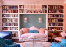 Eclectic living room with a wall of books