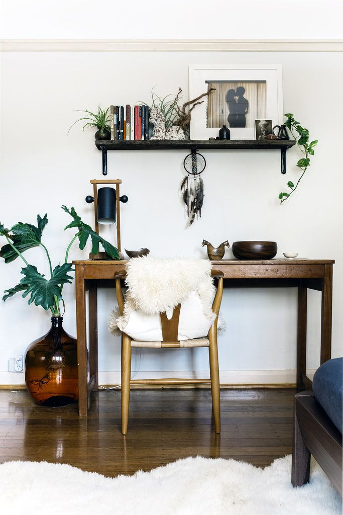 Eclectic office space with wood furniture and touches of greenery