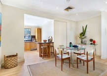 Elegant-modern-dining-space-and-kitchen-on-the-second-level-of-converted-warehouse-home-in-Sydney-217x155
