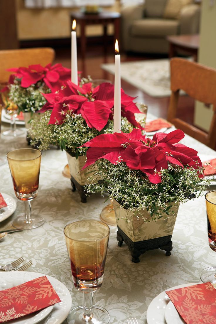 Elegant poinsettia and candlestick centerpieces