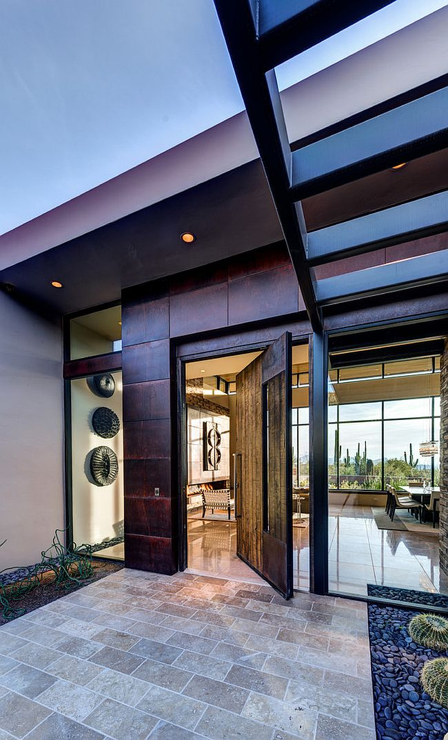 Entrance of the desert home with a swivel door