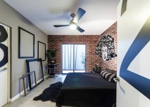 Exposed-brick-wall-grafitti-and-giant-empty-picture-frames-come-together-to-fashion-an-exclusive-bedroom-217x155