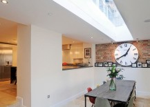 Exposed-brickwork-inside-the-breezy-contemporary-dining-room-217x155