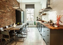 Exposed brickwork, tile and gray cabinets for a loft style kitchen with space-savvy design [Design: Compass and Rose]